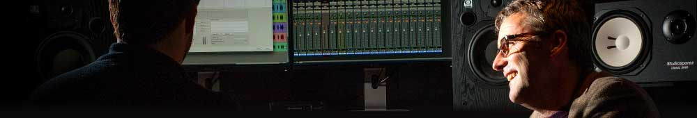 Two people working in a recording studio.